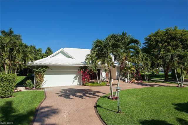 Photo of 12 Sabre LN, NAPLES, FL 34102 (MLS # 221011093)