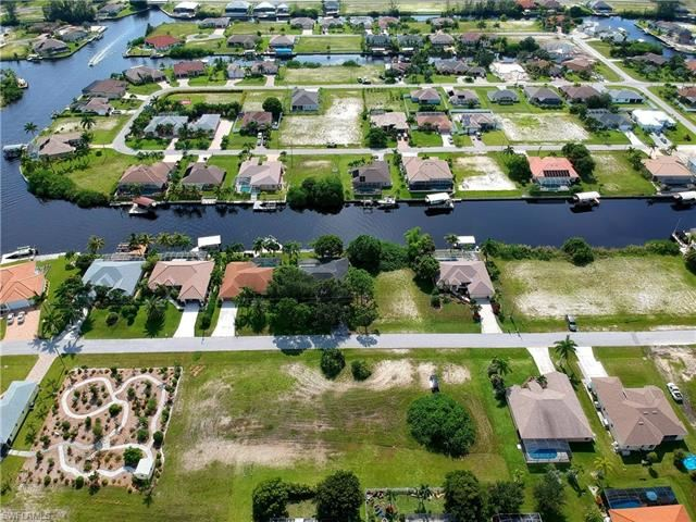 Photo of 417 NW 37th PL, CAPE CORAL, FL 33993 (MLS # 221056119)