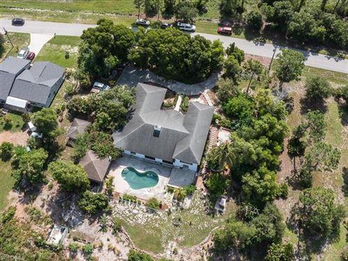 Photo of 27174 Pinecrest LN, BONITA SPRINGS, FL 34135 (MLS # 221076212)