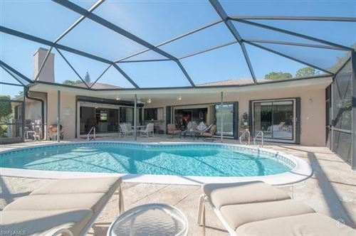 Photo of 1914 Imperial Golf Course BLVD, NAPLES, FL 34110 (MLS # 220003223)