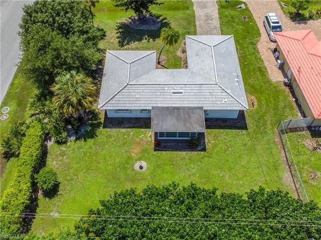 Photo of 4941 Cortez CIR, NAPLES, FL 34112 (MLS # 221047256)