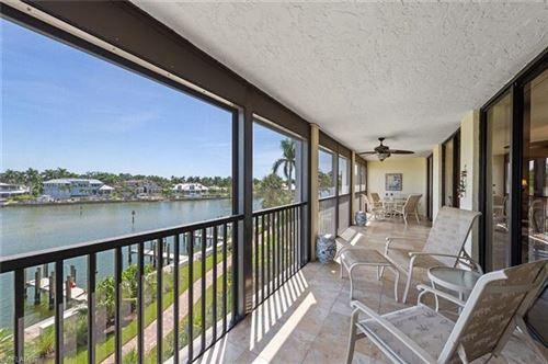 Photo of 2400 Gulf Shore BLVD N #302, NAPLES, FL 34103 (MLS # 220061271)