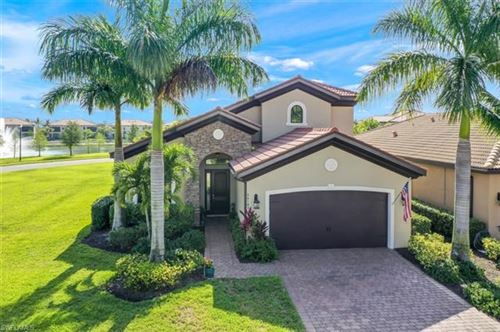 Photo of 26103 Grand Prix DR, BONITA SPRINGS, FL 34135 (MLS # 220031287)