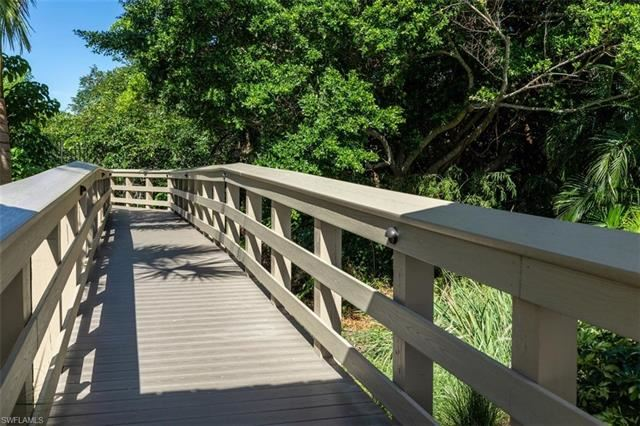 Photo of 5501 Heron Point DR #301, NAPLES, FL 34108 (MLS # 221051395)