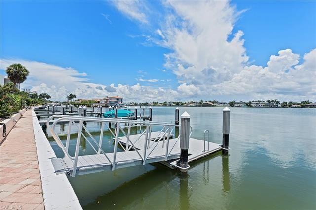 Photo of 3450 Gulf Shore BLVD N #202, NAPLES, FL 34103 (MLS # 221056423)