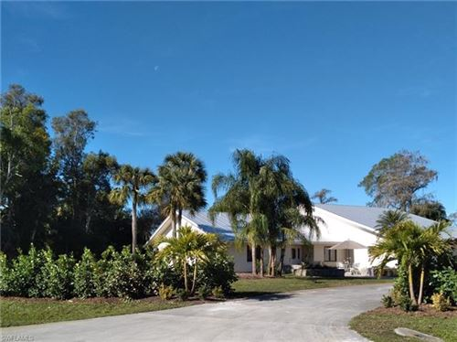 Photo of 883 Cassena RD, NAPLES, FL 34108 (MLS # 221005452)