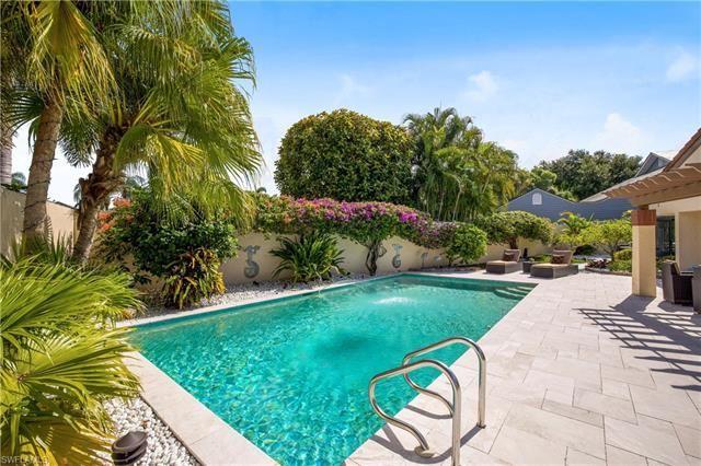 Photo of 598 Bay Villas LN #83, NAPLES, FL 34108 (MLS # 221049458)