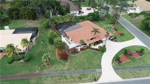 Photo of 1963 Imperial Golf Course BLVD, NAPLES, FL 34110 (MLS # 220033472)
