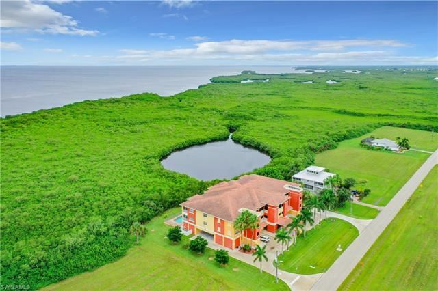Photo of 17495 Boca Vista RD #3, PUNTA GORDA, FL 33955 (MLS # 221056499)