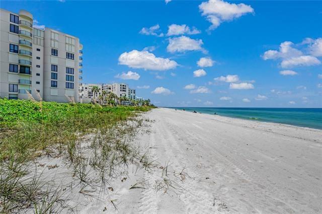 Photo of 3215 Gulf Shore BLVD N #211N, NAPLES, FL 34103 (MLS # 221063532)