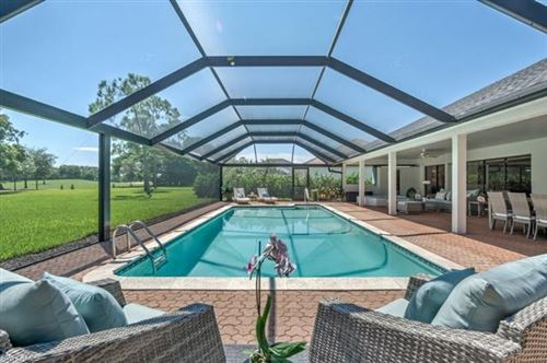 Photo of 1992 Imperial Golf Course BLVD, NAPLES, FL 34110 (MLS # 221055539)