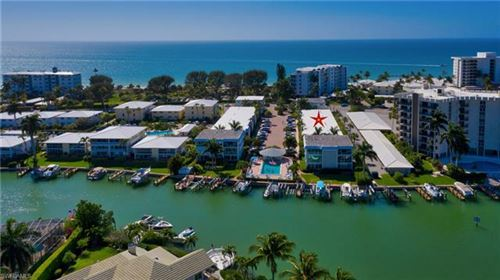 Photo of 2100 Gulf Shore BLVD N #107, NAPLES, FL 34102 (MLS # 221037584)