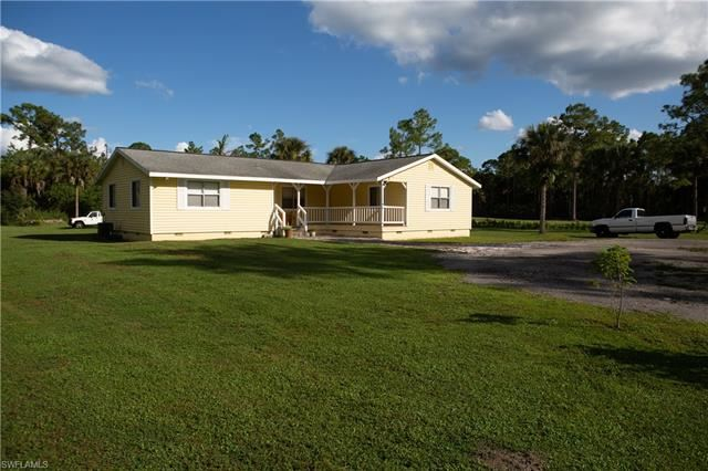 Photo of 460 11th ST SW, NAPLES, FL 34117 (MLS # 221073588)