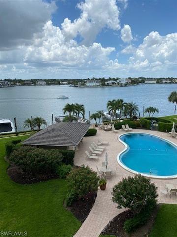 Photo of 3500 Gulf Shore BLVD N #406, NAPLES, FL 34103 (MLS # 221043594)