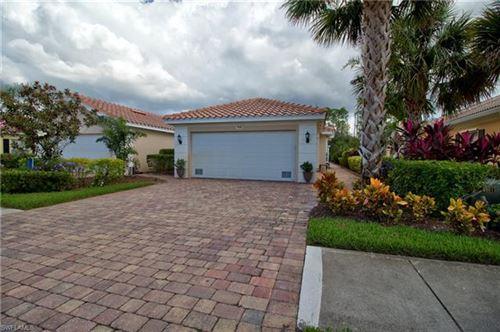 Photo of 7649 Rozzini LN, NAPLES, FL 34114 (MLS # 221052669)