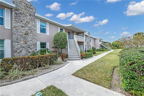 Photo of 221 Cypress WAY E #203, NAPLES, FL 34110 (MLS # 221009788)