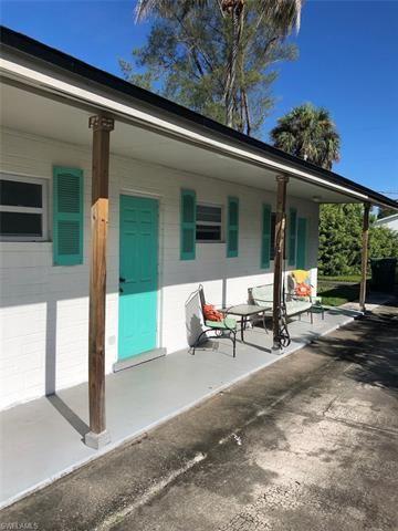 Photo of 853 91st AVE N, NAPLES, FL 34108 (MLS # 221067790)