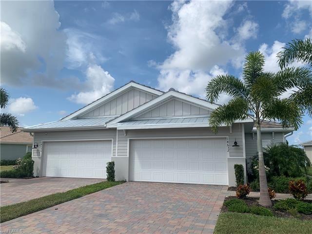 Photo of 14632 EDGEWATER CIR, NAPLES, FL 34114 (MLS # 221052807)