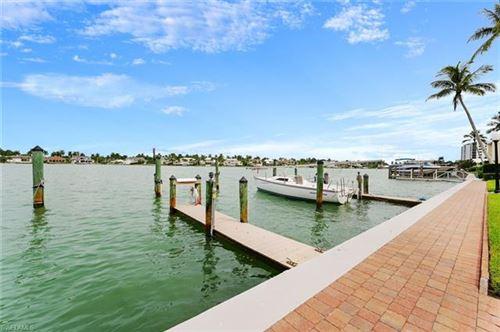 Photo of 2800 Gulf Shore BLVD N #105, NAPLES, FL 34103 (MLS # 221015822)