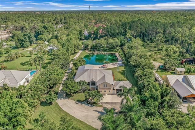 Photo of 5823 Spanish Oaks LN, NAPLES, FL 34119 (MLS # 221055856)