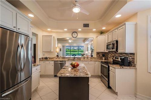 Photo of 6069 Ashford LN #7-702, NAPLES, FL 34110 (MLS # 220074872)