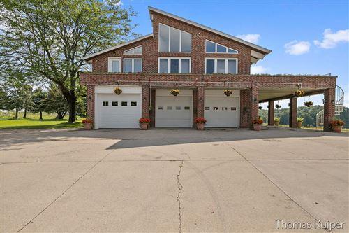 Photo of 2850 9 Mile Road NW, Grand Rapids, MI 49544 (MLS # 21101081)