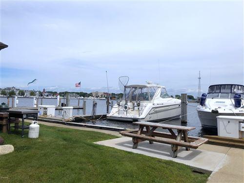 Photo of 10 Harbor Drive #10, Ludington, MI 49431 (MLS # 20029090)