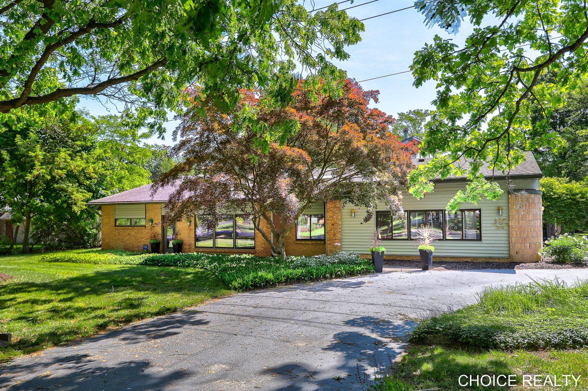 Photo of 1646 Thornapple River Drive SE, Grand Rapids, MI 49546 (MLS # 21010147)