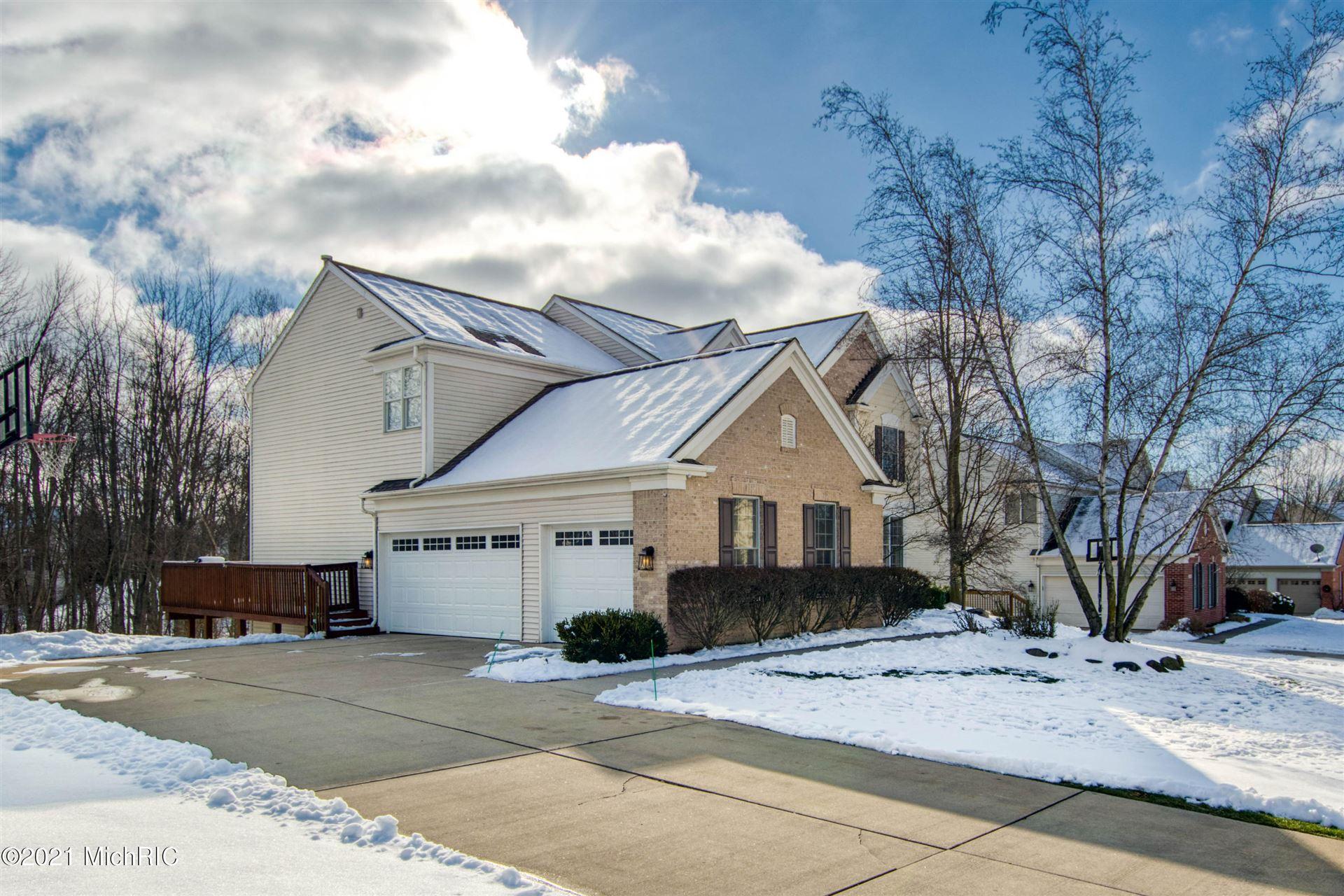 Photo of 356 Quail Ridge Drive NE, Ada, MI 49301 (MLS # 21001174)