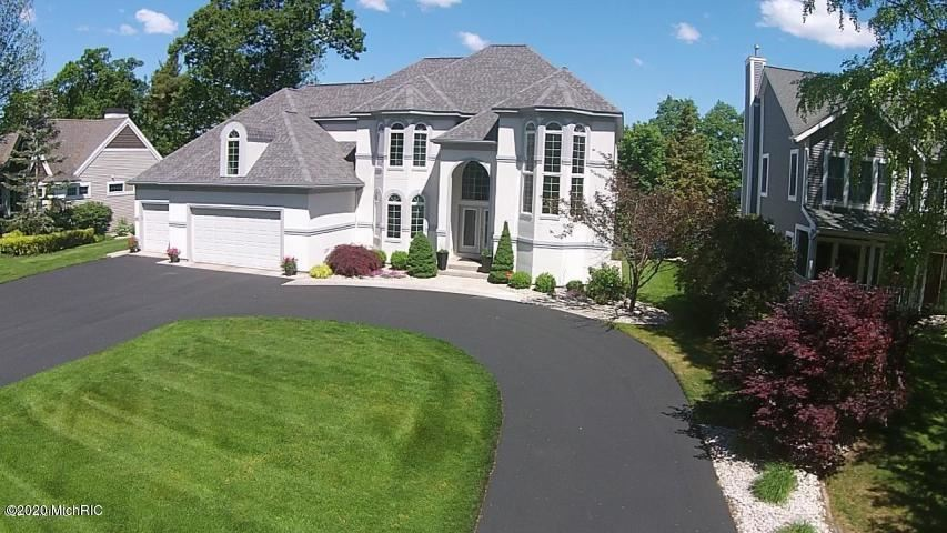 Photo of 15495 Oak Ridge Drive, Spring Lake, MI 49456 (MLS # 20004175)