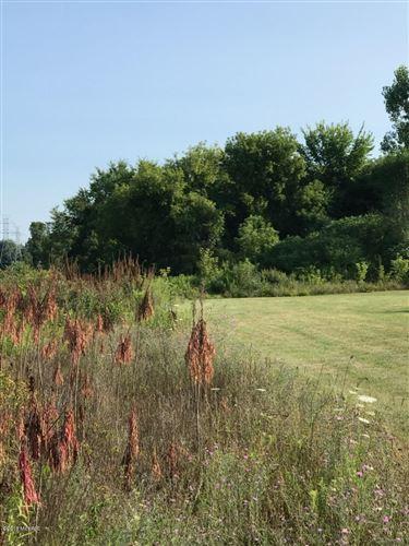 Photo of 224 7 Mile Road NE, Comstock Park, MI 49321 (MLS # 18036294)