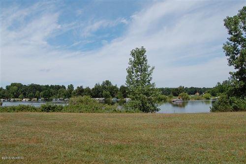 Photo of 10090 E Royal Road, Canadian Lakes, MI 49346 (MLS # 18057305)