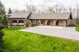 Photo of 1187 3 Mile Road NW, Grand Rapids, MI 49544 (MLS # 19004331)