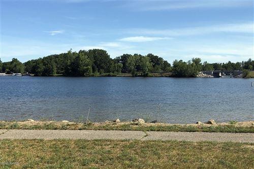 Photo of 10425 Maple Crossing #11, Canadian Lakes, MI 49346 (MLS # 20035341)