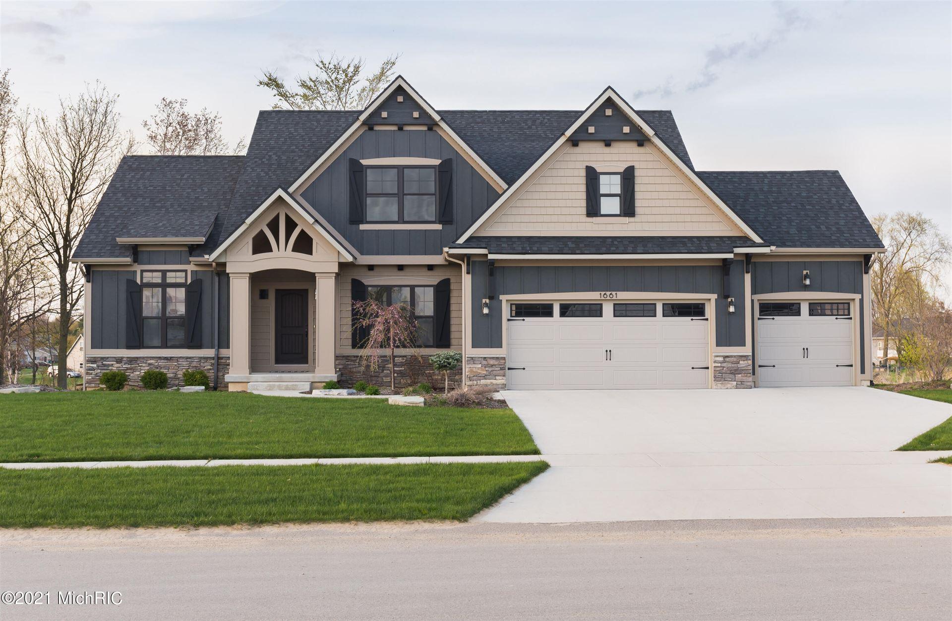 Photo of 4896 Prairie River Drive SE, Grand Rapids, MI 49512 (MLS # 21021364)