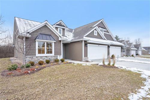 Photo of 6783 Creekside View Drive SE #1, Grand Rapids, MI 49548 (MLS # 21011548)