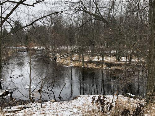 Photo of 4356 Lake Montcalm Road NW, Six Lakes, MI 48886 (MLS # 20001595)