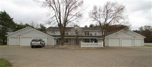 Photo of 636 6 Mile Road NW, Comstock Park, MI 49321 (MLS # 19015636)