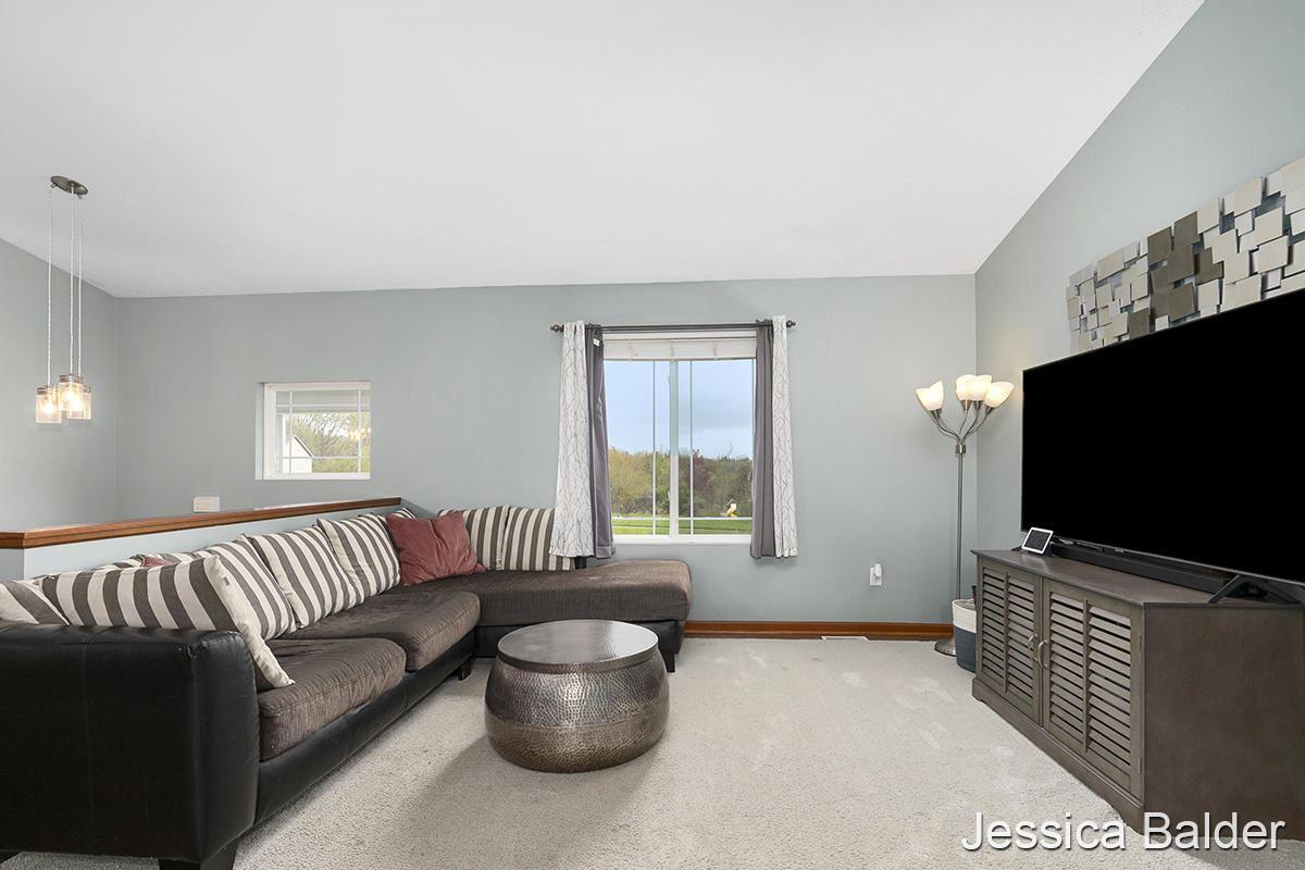 Photo of 4020 Whirlwind Drive NE, Rockford, MI 49341 (MLS # 21015719)