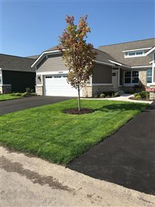 Photo of 10179 E Crossroads Circle SE #31, Caledonia, MI 49316 (MLS # 18046761)