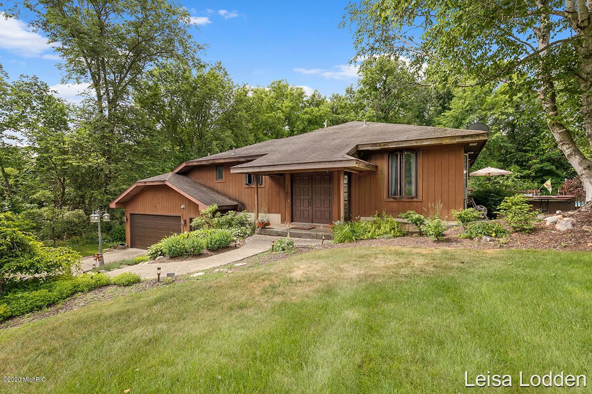 Photo of 5450 Canyon River Drive NE, Ada, MI 49301 (MLS # 20024776)