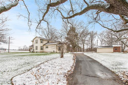 Photo of 1609 Greenly Street, Grandville, MI 49418 (MLS # 21001778)