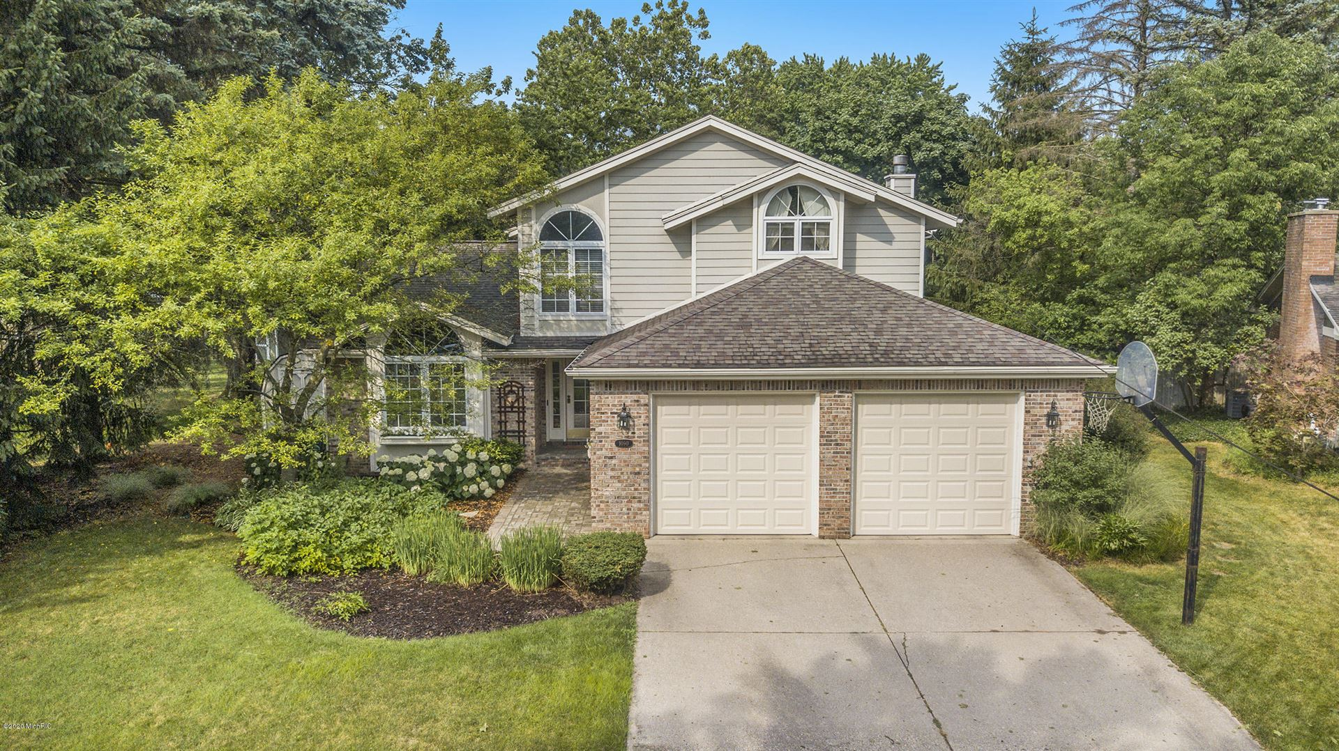 Photo of 1090 Idema Drive SE, East Grand Rapids, MI 49506 (MLS # 20026803)