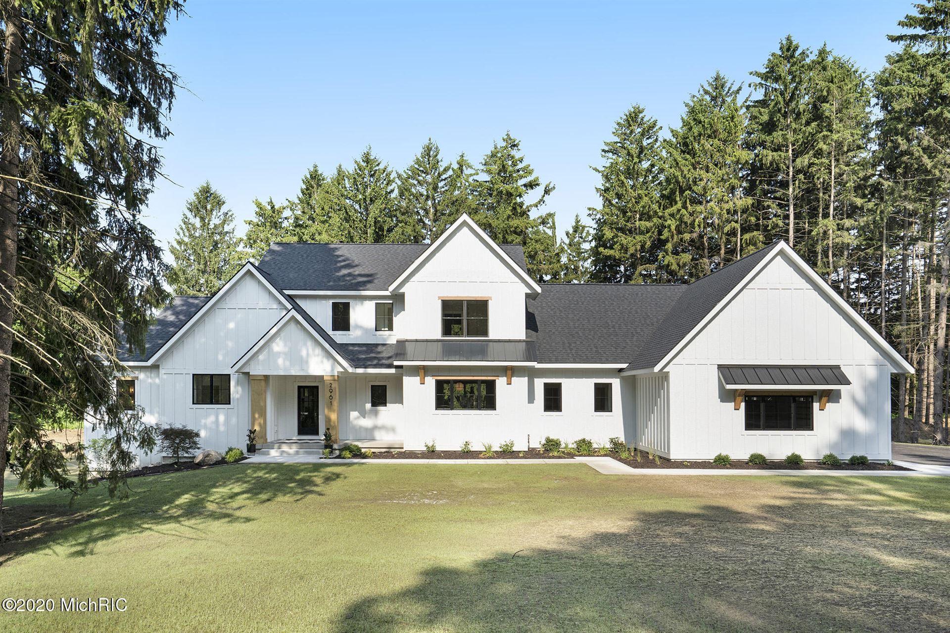Photo of 5108 Hickory Pointe Woods SE, Ada, MI 49301 (MLS # 20050891)