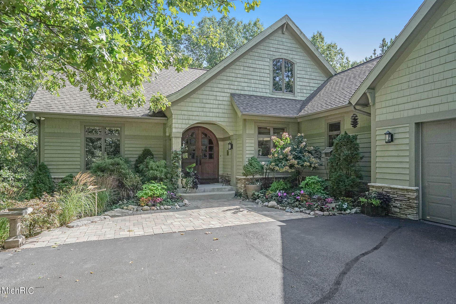 Photo of 9100 Twin Oaks Lane NE, Ada, MI 49301 (MLS # 21011929)
