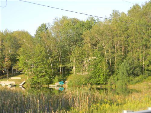Photo of 8601 N Island Drive, Canadian Lakes, MI 49346 (MLS # 21101973)