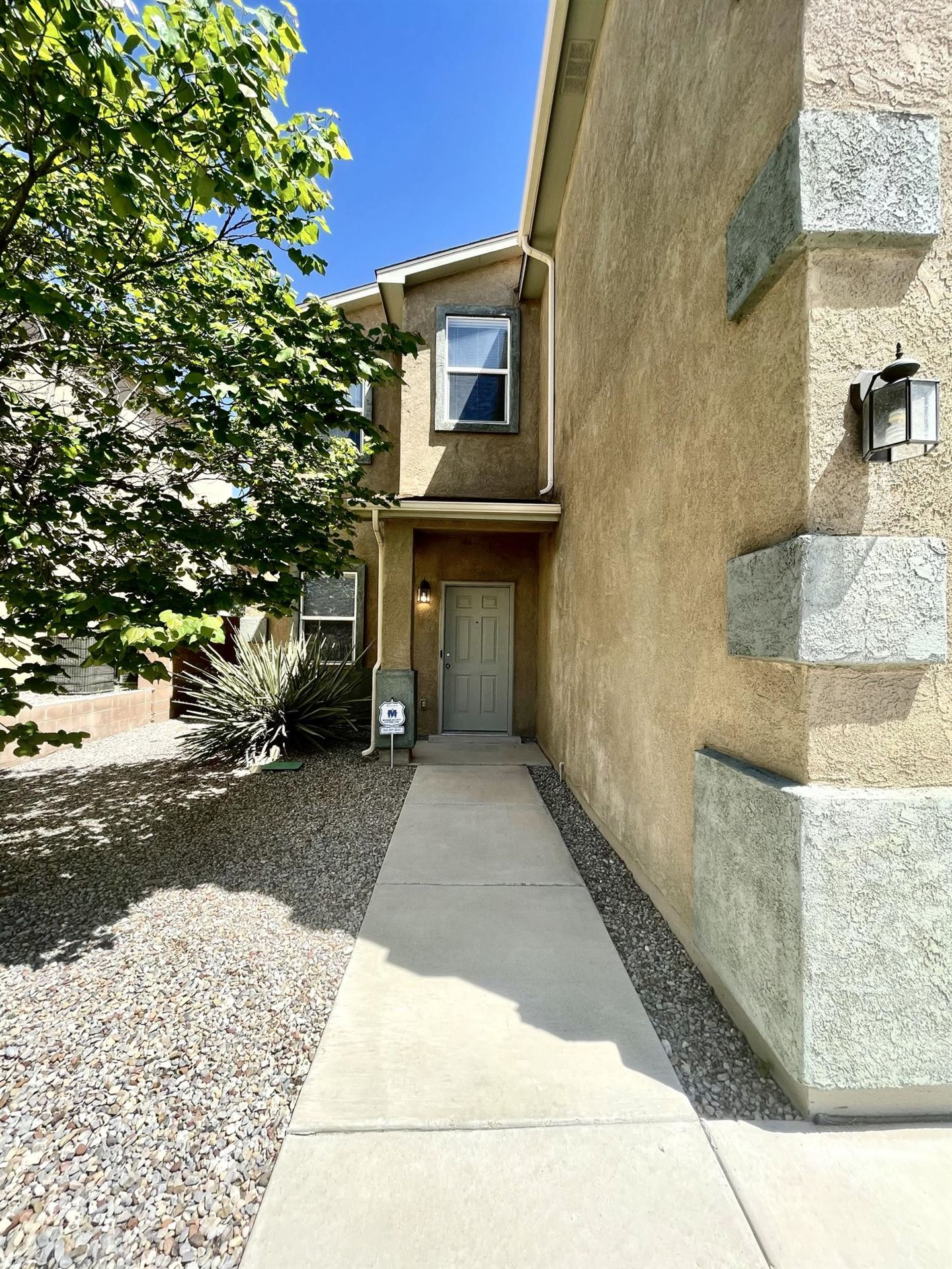 Photo of 7309 HEARTHSTONE Road NW, Albuquerque, NM 87114 (MLS # 989089)