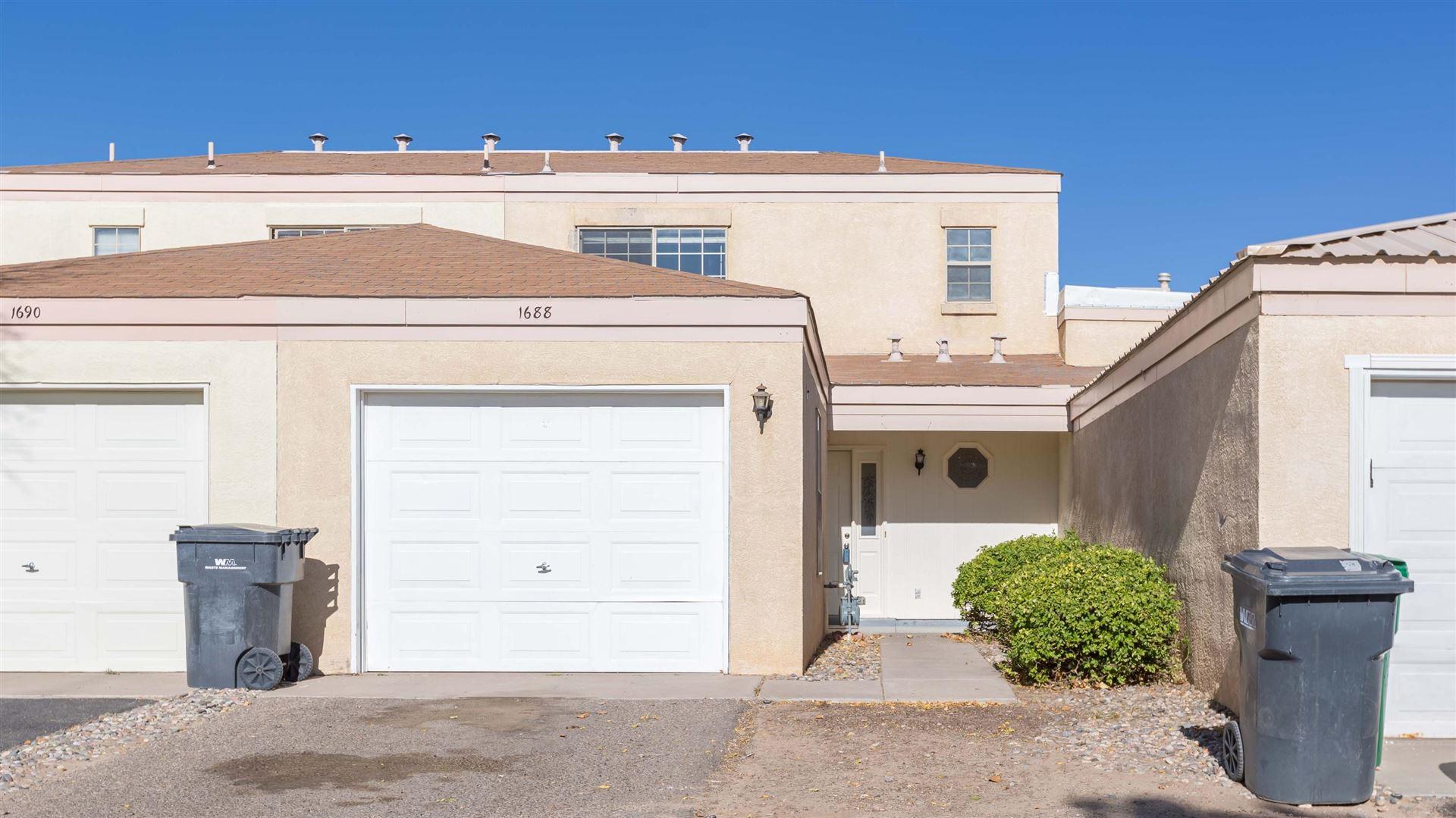 Photo of 1688 PERMA Drive NE, Rio Rancho, NM 87144 (MLS # 979106)