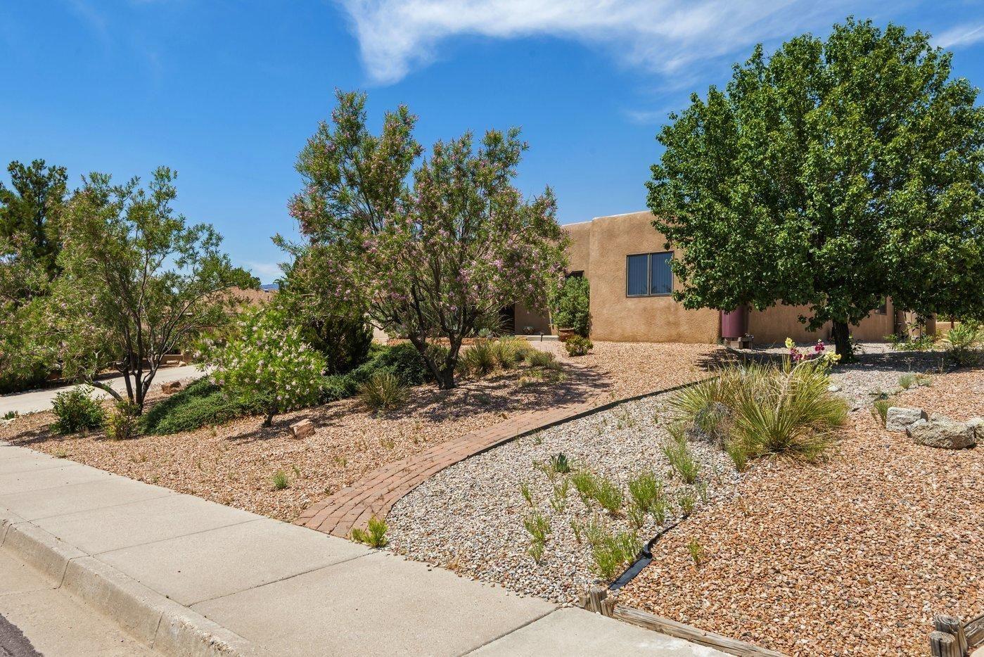 Photo of 14207 Sunglow Road NE, Albuquerque, NM 87123 (MLS # 994295)