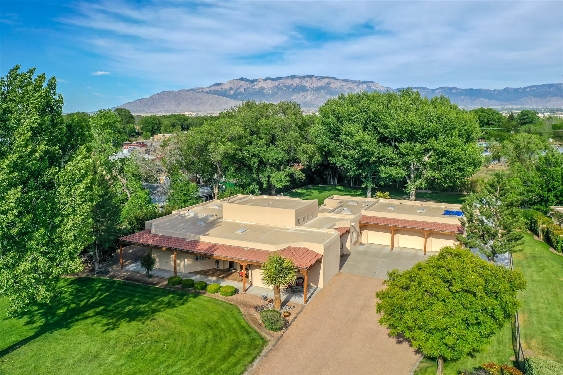 Photo of 714 RANCHITOS Road NW, Los Ranchos, NM 87114 (MLS # 968310)